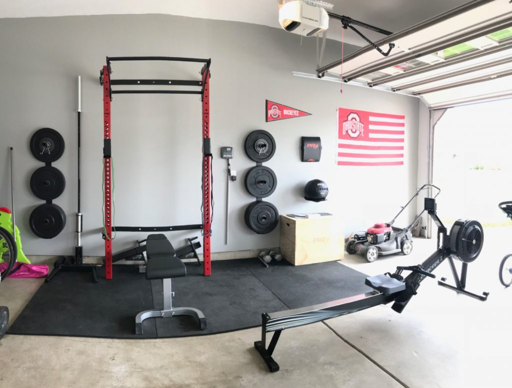 Organized picture of a squat rack and rower