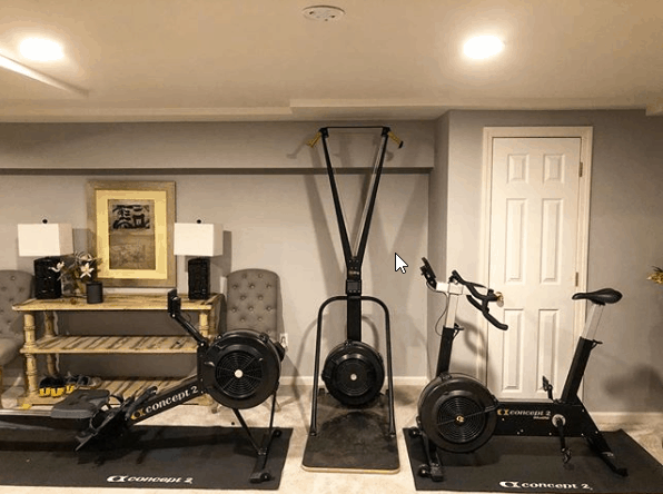A simple gym with rower and bike in lovely home