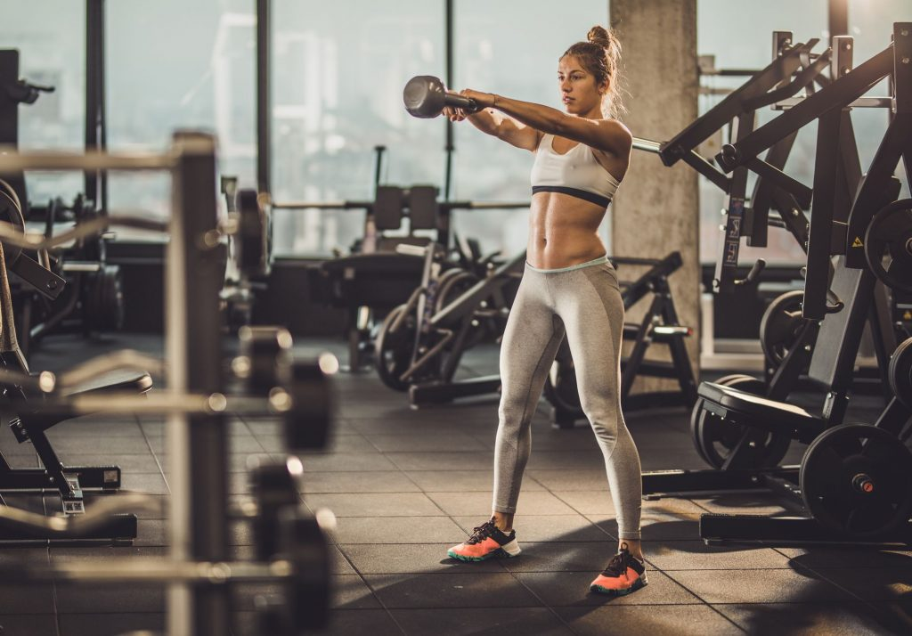 female with kettlebell workout